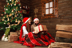 Happy Christmas couple in celebrating in the old wooden house Royalty Free Stock Photo