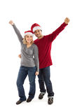 Happy Christmas couple cheering Stock Photography