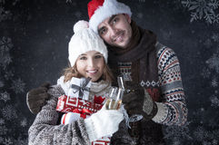 Happy Christmas couple with glasses  and gifts Royalty Free Stock Photography