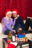 Happy Christmas couple home Stock Image