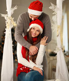 Happy Christmas couple in love at home Royalty Free Stock Photography