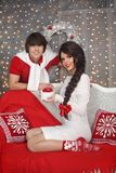 Happy Christmas couple in love. Young handsome man present gift. Happy Christmas couple in love. Young handsome men present gift box his pretty brunette Stock Images