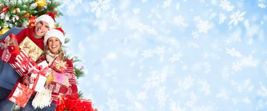 Happy christmas couple over snowy background. Royalty Free Stock Photography