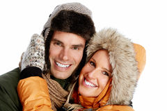Happy christmas couple in winter clothing. Royalty Free Stock Image