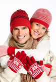 Happy christmas couple in winter clothing. Royalty Free Stock Photos