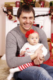 Happy Christmas father and his baby Stock Image