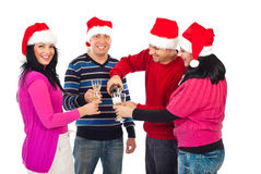 Happy Christmas friends pouring champagne royalty free stock images