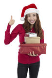 Happy christmas gift woman showing thumbs up Royalty Free Stock Photo