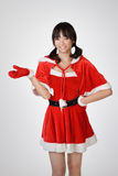 Happy Christmas gir. L introduce over gray studio background Royalty Free Stock Photo
