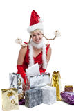 Happy christmas girl. Cute young girl in christmas outfit with presents Royalty Free Stock Photo