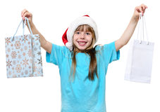 Happy christmas girl hold big shopping bags. royalty free stock photo