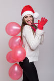 Happy Christmas girl holding balloons waving Stock Photography