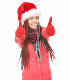 Happy christmas girl with plaits and thumbs up Royalty Free Stock Images