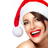 Happy Christmas Girl in Santa Hat. Beautiful Big Smile Royalty Free Stock Image