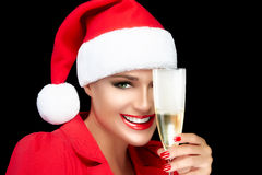 Happy Christmas Girl in Santa Hat Toasting with champagne. Cheer Stock Images