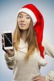 Happy christmas girl showing smartphone Stock Photography