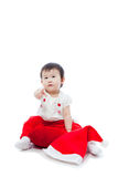 Happy christmas girl sitting and pointing Royalty Free Stock Photos