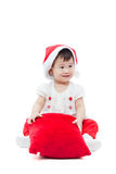 Happy christmas girl sitting and smiling Royalty Free Stock Photography