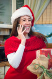 Happy Christmas girl talking on cell phone. Royalty Free Stock Photo
