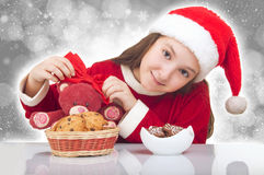 Happy Christmas girl with teddy bear. And cookies royalty free stock photography