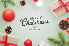 Happy Christmas greeting card surrounded by decorations and gifts stock photo