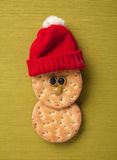 Happy Christmas hardtack in santa hat Stock Image