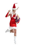 Happy christmas jump. Cute young girl jumping high with a happy smile (some movement due to jumping Royalty Free Stock Images
