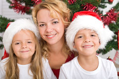 Happy christmas kids and woman Royalty Free Stock Photos