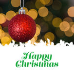 Happy Christmas message. Happy christmas against red christmas ball decoration hanging Stock Photo