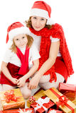 Happy Christmas mother and daughter with presents Stock Photo