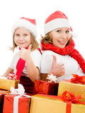 Happy Christmas mother and daughter with presents Royalty Free Stock Photos