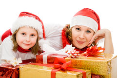 Happy Christmas mother and daughter with presents Royalty Free Stock Photography