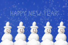 Happy Christmas and New Year message, five smiling snowmen again. St blue background with snowflakes, greeting card design Stock Images