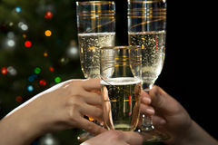 Happy Christmas. People hands with glasses Royalty Free Stock Image