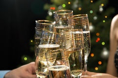 Happy Christmas. People hands with glasses