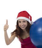Happy christmas pilates woman thumb up Stock Images
