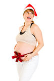 Happy christmas pregnant in Santa hat with ribbon Stock Photography