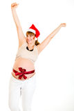 Happy christmas pregnant woman in Santa hat Royalty Free Stock Image