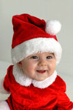Christmas time - happy Santa baby in red Stock Image