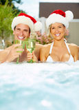 Happy Christmas santa couple in jacuzzi. Royalty Free Stock Photos