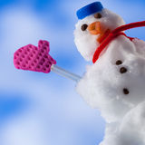 Happy christmas snowman with pink gloves waving to you outdoor. Winter. Royalty Free Stock Images