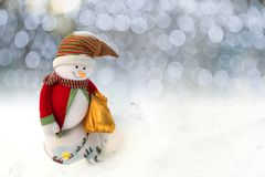 Happy Christmas Snowman in Santa Claus dress stock photo