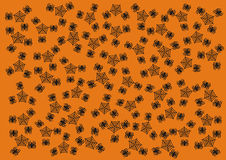 Happy Halloween Wallpaper Background Giftwrap. Creepy spiders and their webs form a random pattern on a bright orange background; perfect for a Happy Halloween Stock Photos