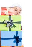 Happy Christmas woman behind presents Stock Images