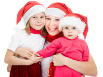 Happy Christmas woman with children Royalty Free Stock Photos