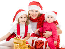 Happy Christmas woman with children Royalty Free Stock Images