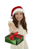 Happy christmas woman giving a gift with the focus on the box Stock Image