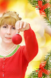 Happy Christmas with woman giving a red bauble Stock Image