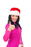 Happy Christmas woman giving thumbs royalty free stock photo