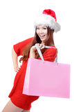 Happy christmas woman hold big shopping bag. Isolated over white background, model is a asian girl Stock Photography